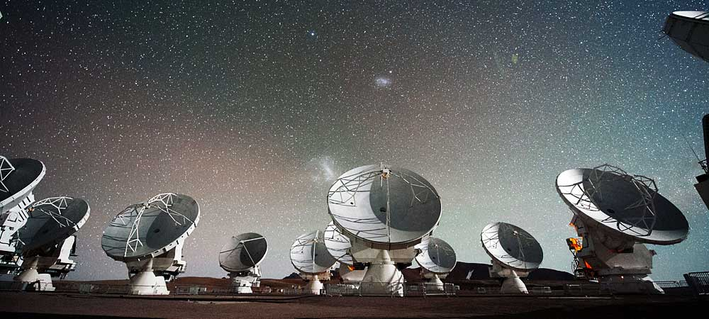 View of ALMA during its Early Science observing phase in late 2011. Telescopes from all three partners are in the array, including the smaller, 7-meter Japanese telescopes that make up the Atacama Compact Array.