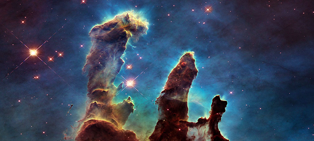 Eagle Nebula's Pillars of Creation captured by Hubble. The pillars are seen here in visible light.