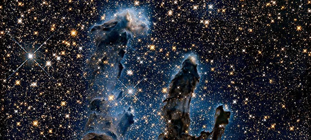 Eagle Nebula's Pillars of Creation captured by Hubble. The pillars are seen here in infrared light.