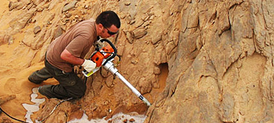 Libya: Taking field samples for porosity and permeability, fieldwork on the Ordovician of Libya.